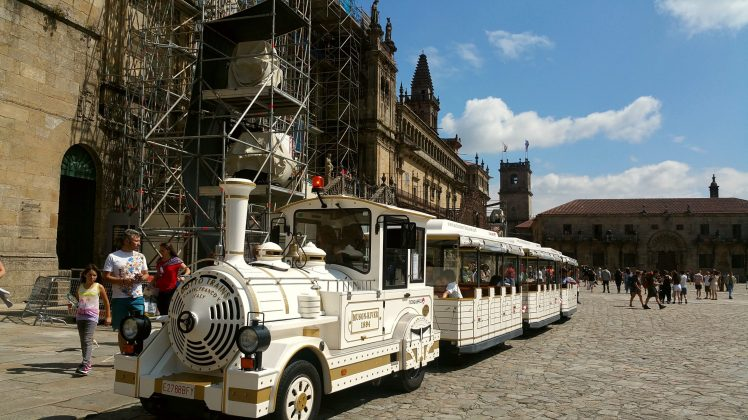 The touristic train passing near the Cathedral of Santiago.
