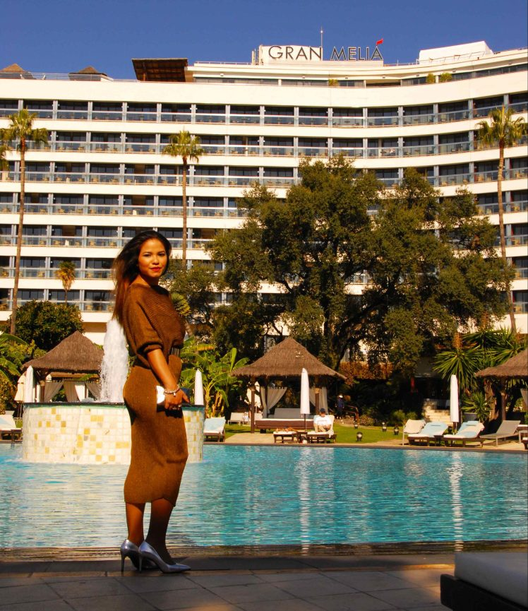 Striking a pose near the pool area.